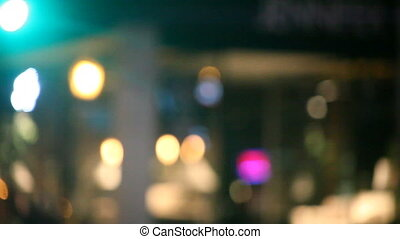 urban night scene - view from a car of defocused parked...