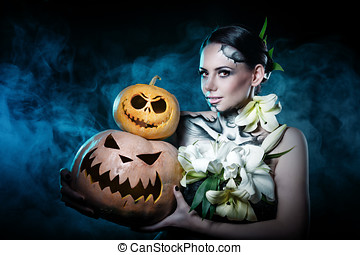 Girl with makeup for Halloween Pumpkins - Young attractive...