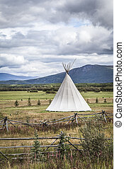 Tipi with storm clouds - Tipi in rural Canada with storm...
