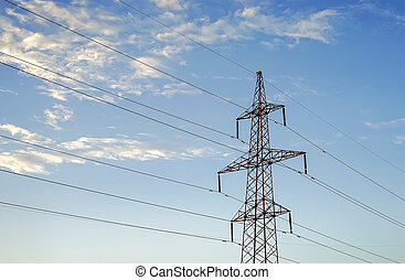 Electricity pylon against the blue sky background.