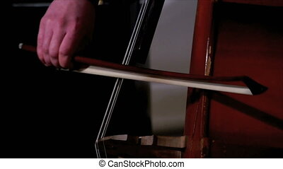 View of cellist's hands with fiddlestick, close-up