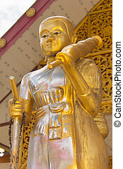 golden thai monk statue in temple