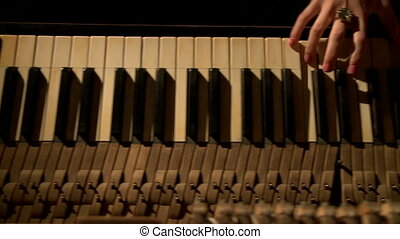 View of woman with manicured hands playing piano - Top view...