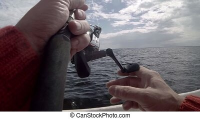fishing from a boat turns fishing reel