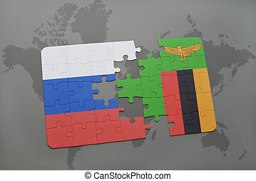 puzzle with the national flag of russia and zambia on a...