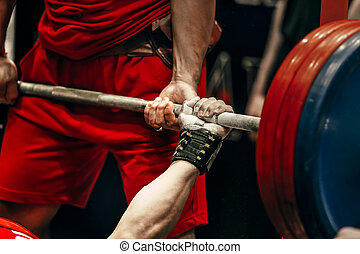 male athlete powerlifter bench press in powerlifting...