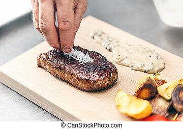 Grilled T-bone steak - Chef decorate grilled T-bone steak...