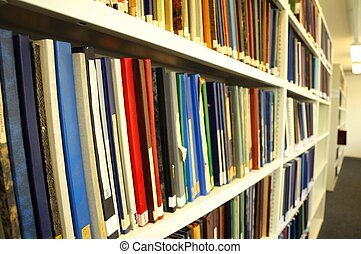 books in a library - education books in a library showing...