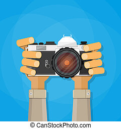 Hands holding photo camera vector illustration in flat style...