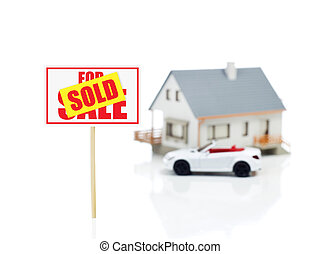 sold sign and house model and car.jpg - sold sign in front...