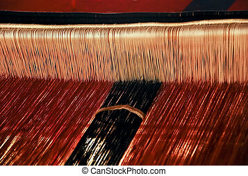 Red and black Loom - Red and black wool on a loom, making a...
