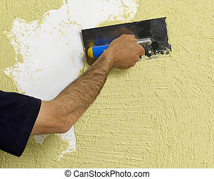 Worker applying plaster on a wall