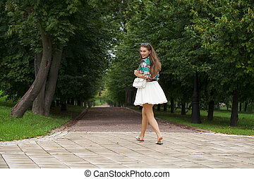 Young brunette woman - Young happy brunette woman in white...