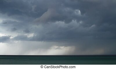 Thunderstorm over the sea - Above the water, the rain,...