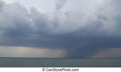 Impending storm at the coast - Storm clouds with rain and...
