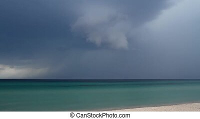 Thunderstorm over the sea - A storm warning. Above the beach...