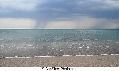 There is a thunderstorm hanging about - Above the calm sea...