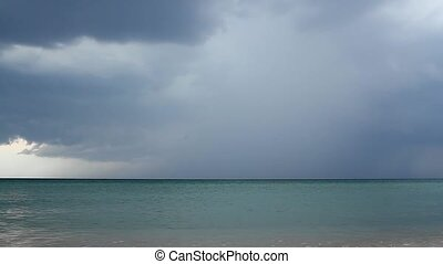 Summer thunderstorm over the ocean - Above the beach begins...