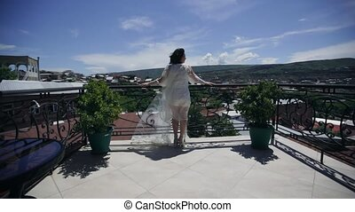 Bride standing on the veranda and looks into the distance...