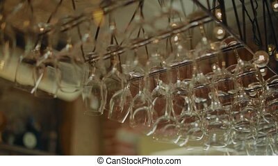Wine glasses hanging above the bar