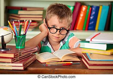 Schoolboy in classroom.