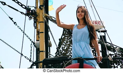 Girl on the ship on the background National colours of...