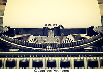 """Words """"Thank you"""" written with old typewriter on white paper..."""