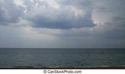 Storm on the coast - Taymlaps. Storm clouds over the sea