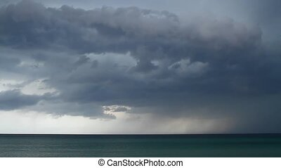 Thunderstorm with lightning over the ocean - Taymlaps. Storm...