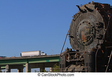 Train Truck Highway 2 - Old rusted train engine against...