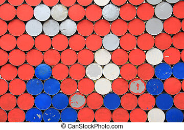 Metal dirty barrels wall - Large metal barrels stacked in a...
