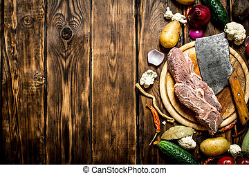 Ingredients for making soup with beef On wooden background