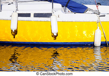 Yellow and blue boat in france