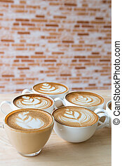 coffee - Selective focus group of latte art coffee cups on...
