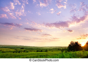 Landscape with a beautiful sky and sunshine through the...