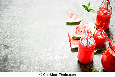 Watermelon juice with mint .