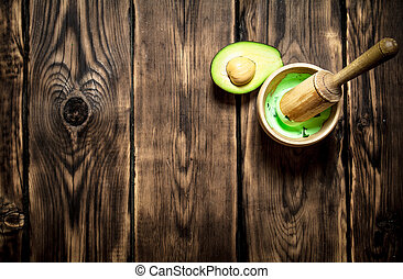 The guacamole in a mortar with pestle