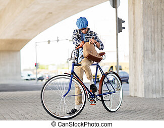 hipster man with shoulder bag on fixed gear bike - people,...