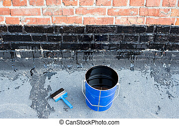 Tools for waterproofing - Ceiling brushes and a bucket of...