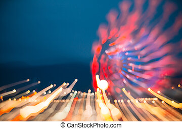 Abstract Motion Blur Image Of Brightly Red Illuminated...