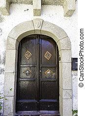 ancient wooden door of wealthy home