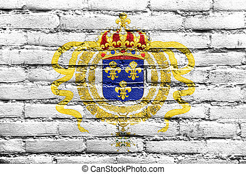 Flag of Acadia, Canada, painted on brick wall