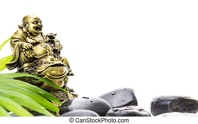 Laughing Buddha and stack of black basalt stones, on white...