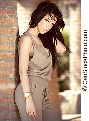 Fashion outdoor portrait of beautiful sexy young woman