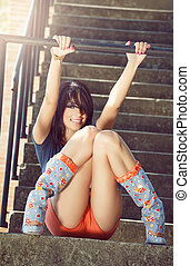 Fashion portrait of happy sexy young woman outdoor