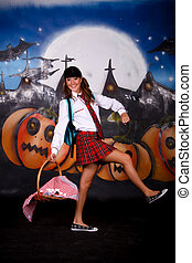 Halloween student sweets - Young Halloween female with...