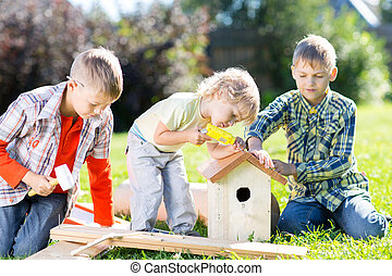 Kids hand working together on loan at summertime - Kids boys...