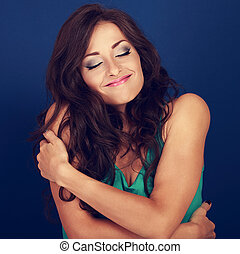 Happy makeup woman hugging herself with natural emotional...
