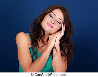Beautiful makeup tired woman want to sleep and she lying on...