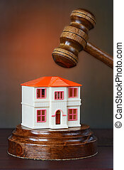 The metaphor of home sale - two-storey toy house and auction...